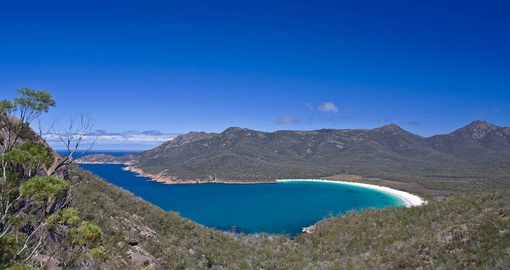 Take in the amazing scenery of Wine Glass Bay on your Australia vacation