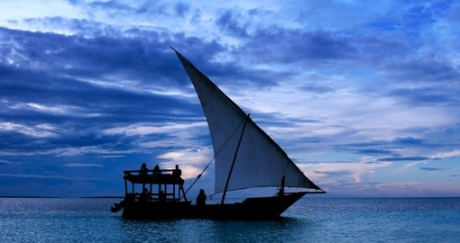 Fishermen Dhow Boat coming back home at sunset from a long day in the sea