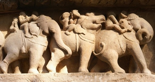 Elephant sculptures on base of Lakshmana Temple is a great photo opportunity on India vacations.