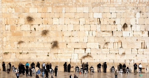 Jewish worshipers pray at the Wailing Wall The most holy site for Jews and always a popular photo opportunity on Israel tours.
