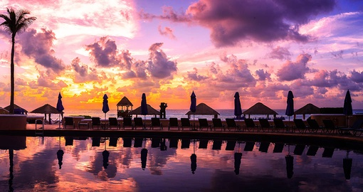 Enjoy a Caribbean sunset in Cancun on your trip to Mexico