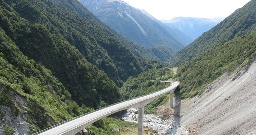 Take a train ride through the majestic Arthur's Pass on your Trips to New Zealand.