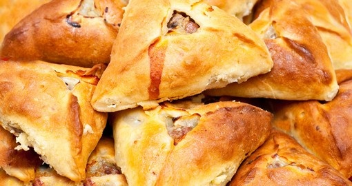 Traditional tatar potato and meat stuffed baked pastry isolated