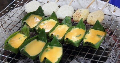 Baked egg cup in banana leaf