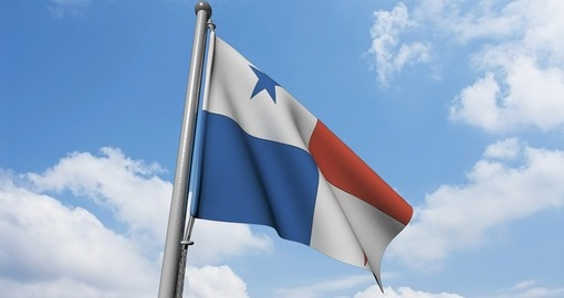 Panama, flag is waving in front of blue sky and puffy clouds