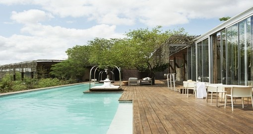 Go swimming in the pool at the Singita Lebombo Lodge during your South Africa vacation.