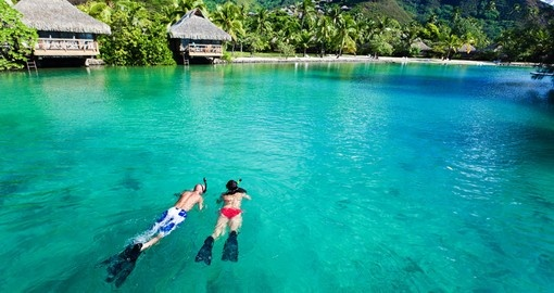 Young couple snorkeling