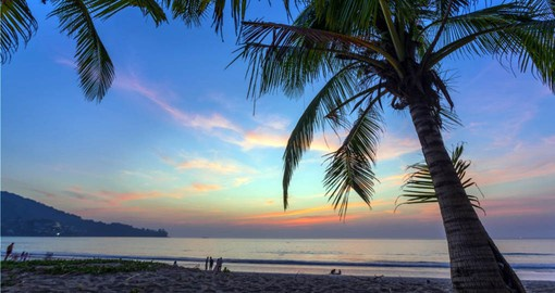 Colourful sunset on Kamala Beach during your Thai vacation