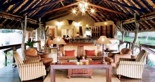 Relax in the common area of Arathusa Safari Lodge on your trip to South Africa