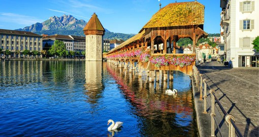 Complete with gable paintings, the covered, medieval Chapel Bridge forms the centrepiece of Lucerne's townscape