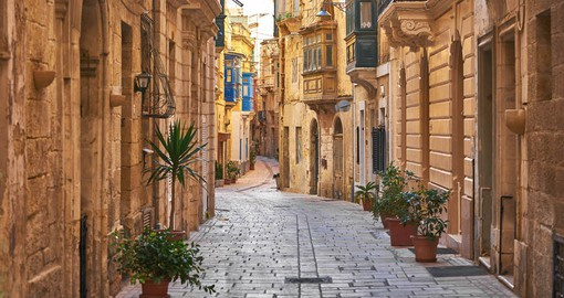 Enjoy an evening stroll through the plazas and cobbled streets of Valletta
