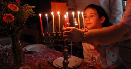 Lighting a candle for Jewish holiday of Hanukkah