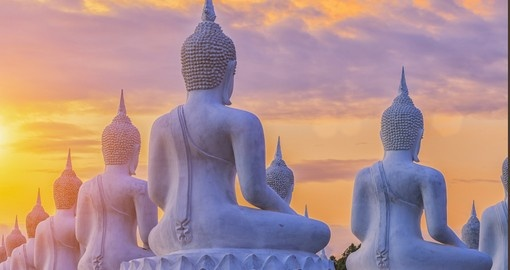 Buddha statues at sunset