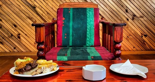 Armchair and table with food in restaurant in Sodwana Bay campsite
