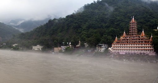 Experience Rishikesh in the mist on your next holiday to India.