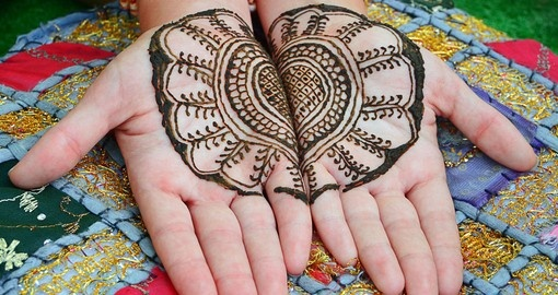 A henna tattoo on womans hands