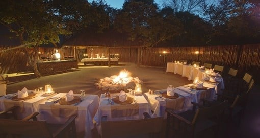 Enjoy a delicious boma dinner at Kapama Buffalo Camp during your trip to South Africa.