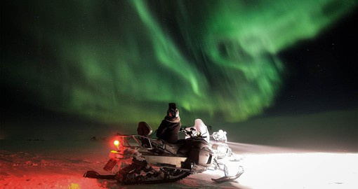Seeing the Northern Lights on a snowmobile safari is a highlight of your Finland holiday.