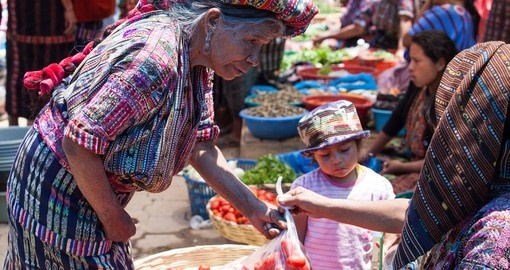 Buy vegetables at a traditional market