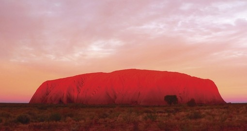 Experience sunrise at Ayers Rock as part of your Australia Vacation