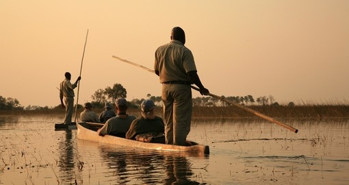 Sailing in traditional mokoro in The Okavango Delta