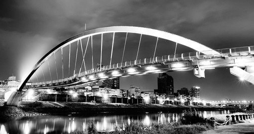 Night lights and a beautiful steel arch bridge