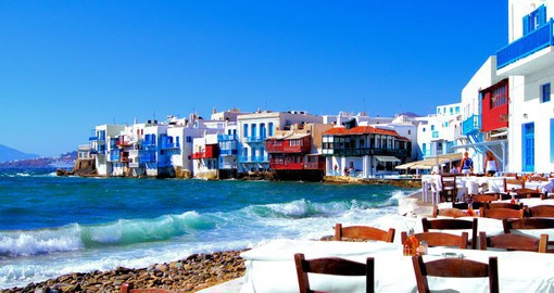 Enjoy a meal seaside in the beautiful decorated Mykonos Village on your Greece Vacation