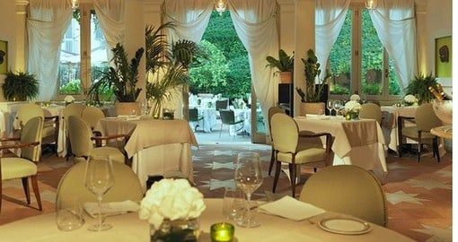 Enjoy an exquisite meal at the Le Jardin De Russie Restaurant as part of your Italy Vacation Package
