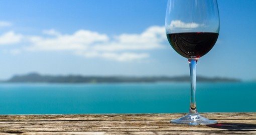 Experience local wine and relax on the beach during your New Zealand Vacation