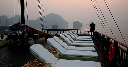 Take in a sunset on your Halong Bay Cruise