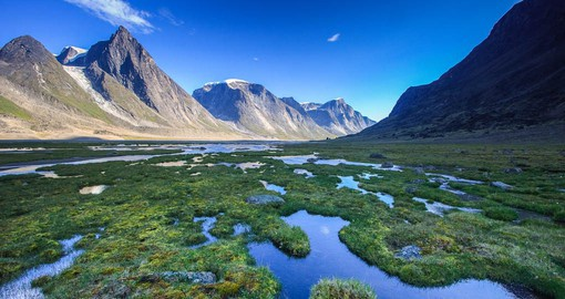 The Akshayuk Pass is a stunning valley surrounded by the southern Baffin Mountains in Nunavut