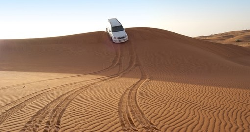 Dune riding in Arabian desert