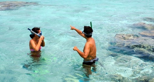 Couple snorkeling in Aitutaki Lagoon