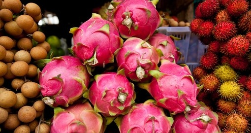 A Colorful Pile of Dragon Fruit in a Street Market