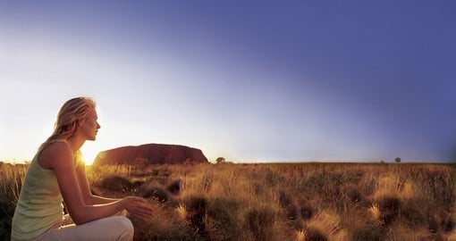 Include a memorable sunset at Uluru on your Australia Outback Vacation.