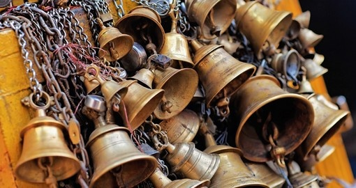Sacrificial bells hanging on chain in Kathmandu