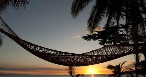 Enjoy lying on the hammock at sunset during your next Fiji vacations.