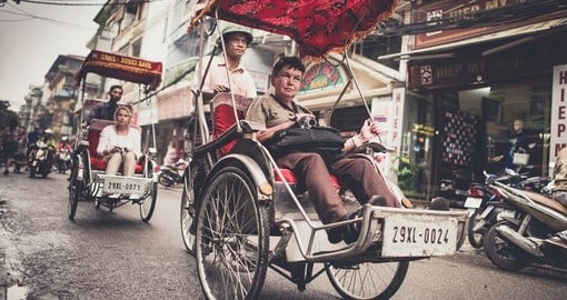 Traditional cycle vehicle in the busy Hanoi traffic