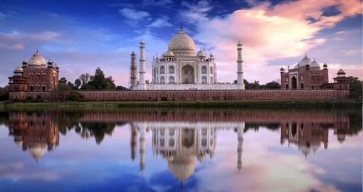 An immense mausoleum of white marble, The Taj Mahal was built by order of Emperor Shah Jahan