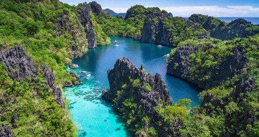 Coast along the calm waterways of El Nido and enjoy your time on its crystal clear waters on one of your Philippine Tours