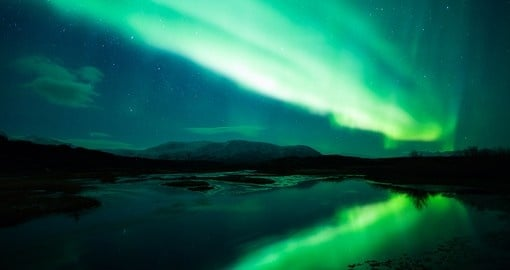 Glowing green Northern Lights - an amazing experience to see on all Finland vacations.