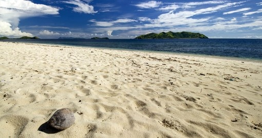Walk on the white sandy beaches in Mamanuca Islands on your next Fiji vacations.