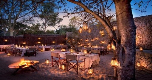 Enjoy a delicious Boma dinner at &Beyond Ngala Safari Lodge during your South Africa trip.