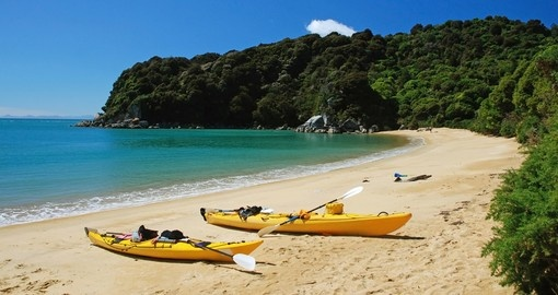 Kayaking in Abel Tasman National Park is a great inclusion on all New Zealand vacations.
