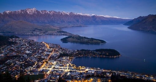 Enjoy beautiful Aerial view of Queenstown at dusk during your next trip to New Zealand.