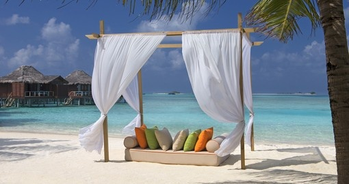 Relax on the white sand beaches of the Maldives with Sun Lounges scattered all over on your Trip to Maldives