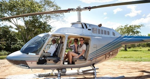 Take a helicopter to your resort on your Belize vacation