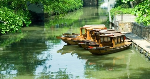 Travelling by boat on the canals of Suzhou is a popular inclusion for China tours.