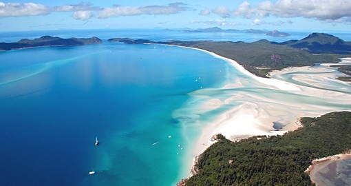 Whitehaven Island - famous for its white sand beach is an ideal inclusion for all Australia vacations.