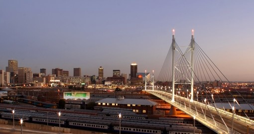 Explore the Downtown Johannesburg skyline with the Mandela Bridge during your next trip to South Africa.
